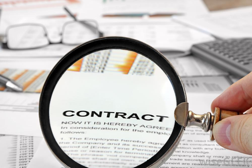magnifying-glass-looking-at-contract